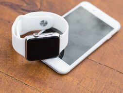 white smartphone and smart watches