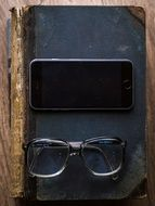 glasses and black smartphone