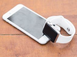 white Iphone and Iwatch