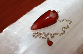 red gemstone Pendulum for Metaphysical use