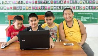 Boys at the laptop, Thailand