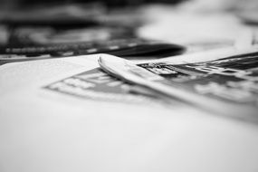 Newspaper, soft focus, black and white