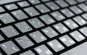 Black keyboard with white letters