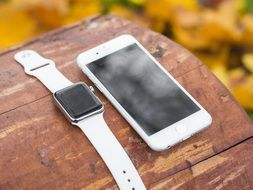 portable white Iphone and Iwatch