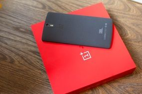 black One Plus smart phone on red box