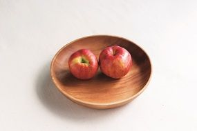 two apples in the wooden bowl