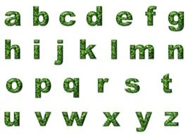 green letters of the English alphabet on a white background