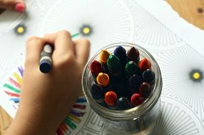 color pencils in a glass on a table for coloring close up