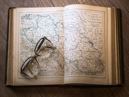 glasses on the map in the book