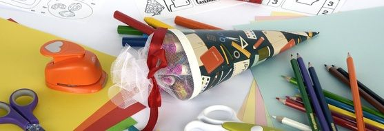 school cone with writing accessories