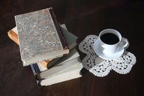 old books and cup of black coffee