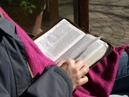 religious man with bible in his hands
