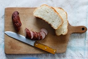 sausage and bread on the cutting board