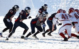 American Football Game on snowy field