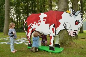 children milking a toy cow
