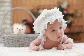 cute baby in the white hat