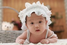cute asian baby in the white hat
