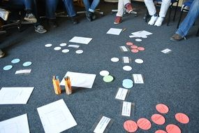 persons' legs, paper cards and pensils on carpet, Group Work, Brainstorming