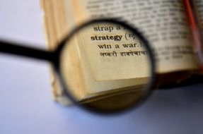 Dictionary under a magnifying glass