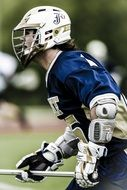 player with stick in lacrosse