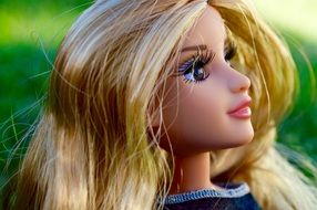 face doll with blond hair close up