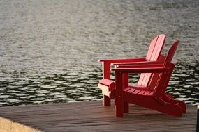 red wooden chair near the lake