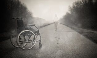 Wheelchair on the road in the fog