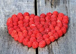 raspberries laid out in the shape of a heart