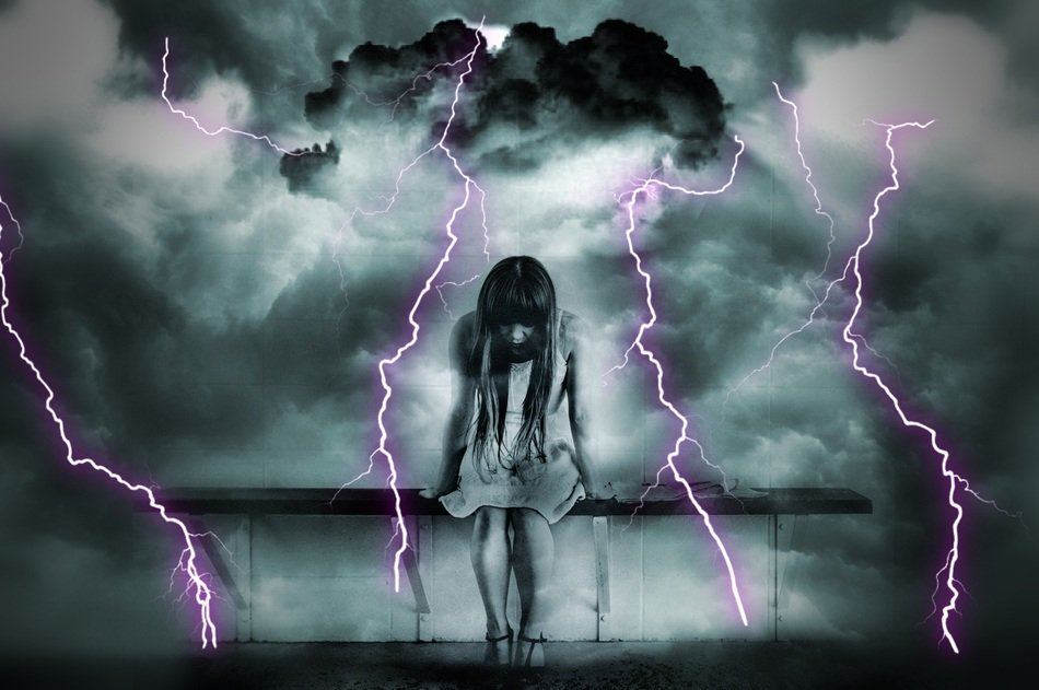 girl on a dark background with lightnings