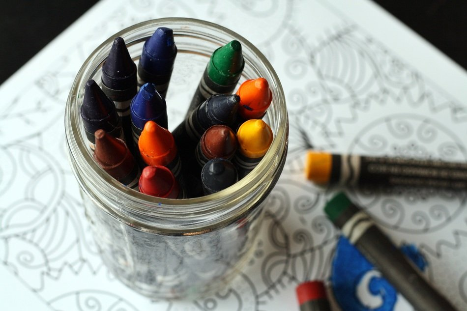 colored pencils in a glass on the table close-up