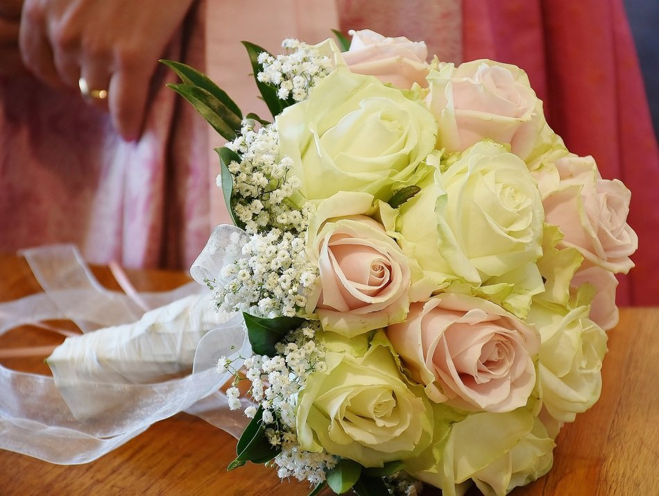 wedding bouquet with roses on the table