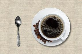 black coffee with coffee beans on the saucer