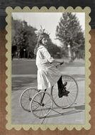 Vintage photo of Girl on a tricycle