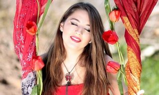 Smiling girl with the red tulips