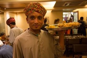 waiter with a tray in india
