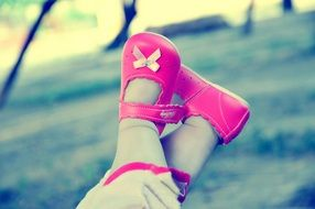 baby feet in pink shoes