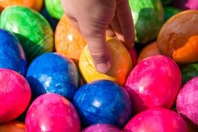 hand on the Easter eggs