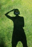 shadow of a girl on green grass