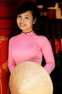 Vietnamese young woman in pink dress