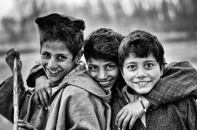 black and white photo of village boys