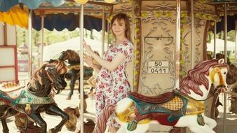 Girl On small Carousel