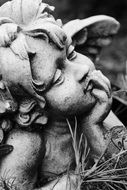 sculpture of a sad angel in a cemetery