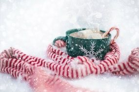 cup with cocoa on the snow