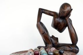 wooden figure of a thinker in a board game