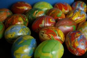 Colorful easter eggs lie in a pile