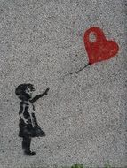 drawing of a girl with a heart-shaped balloon on the wall