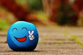 ball with a friendly emoticon