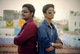 photo of two friends in sunglasses in India