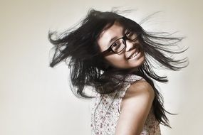 girl with long hair in glasses