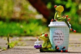 figures of frogs with good day wishes